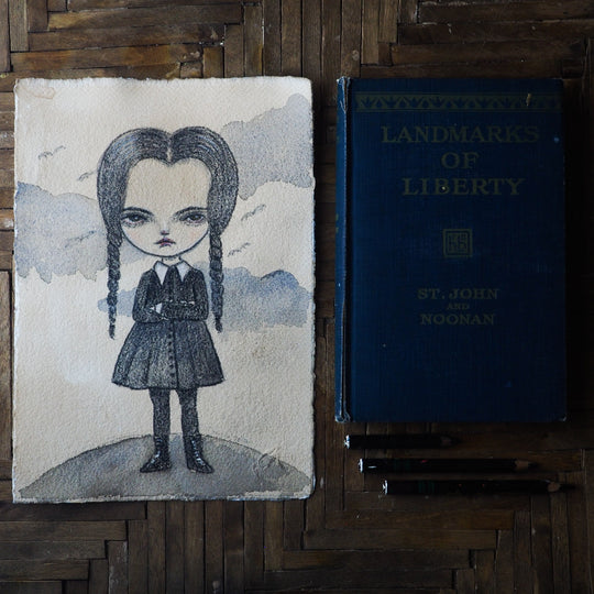 Wednesday Addams in watercolor and pencil by Danita. Creamy paper stands out this illustration on creamy paper. Great for Halloween decoration and any home decor.