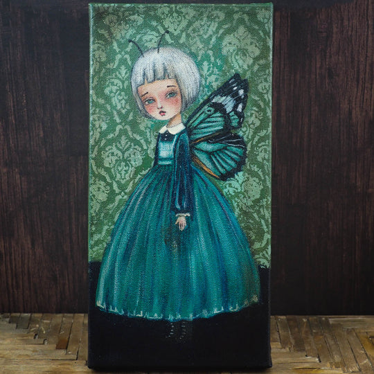 Danita butterfly surrealist folk art painting. Melancholic surreal illustration of moth woman in blue and green.