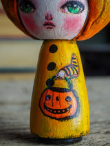 Danita original wooden kokeshi art doll. Home decor Halloween pumpkin jack-o-lantern girl mini figurine, perfect to decorate desks and shelves. Collectible items from Danita!