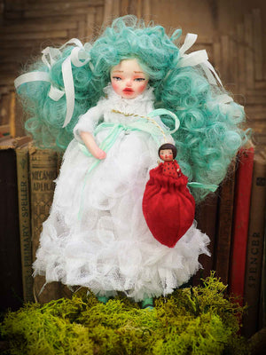 This Danita Art doll was inspired by the stories I made up for Christmas when I was a kid. Wears a fluffy white gown, blue hair has curls. Hands and feet are ceramic I pour myself, and face is sculpted from ceramic and paper clay. Lively eyes and face hand painted and detailed by Danita.