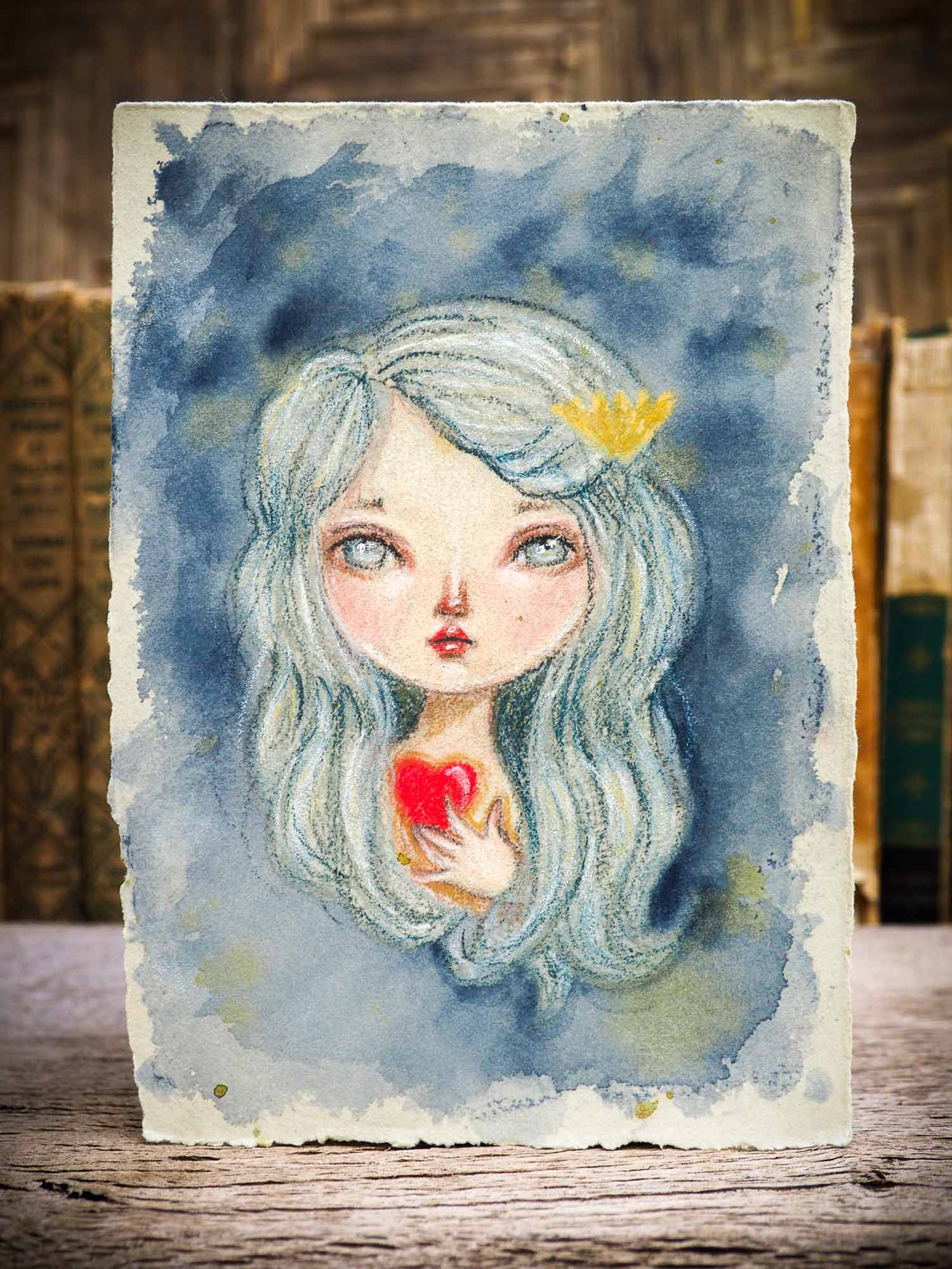 Original Mermaid color pencil and watercolor illustration on hand made paper by Danita Art. A beautiful drawing in colored pencil features fantasy art mermaid and siren with a red heart in her hands by Danita Art.