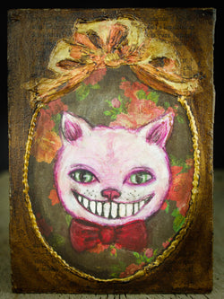 Alice's constant companion on her adventures, the Cheshire Cat is constantly appearing and disappearing when Alice least expects it, and he is grinning a smile without a cat on this painting inspired by Wonderland, created by Danita.