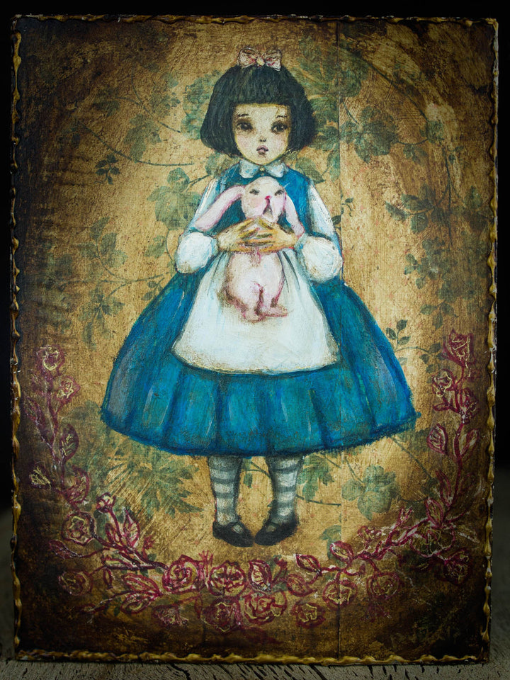 Alice holds the rabbit from Wonderland on this beautiful original mixed media painting by Danita Art.