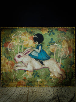 Alice finally caught up with the white rabbit on this surreal painting by Danita, and now they ride together in Wonderland, looking for new adventures for which they will never be late.