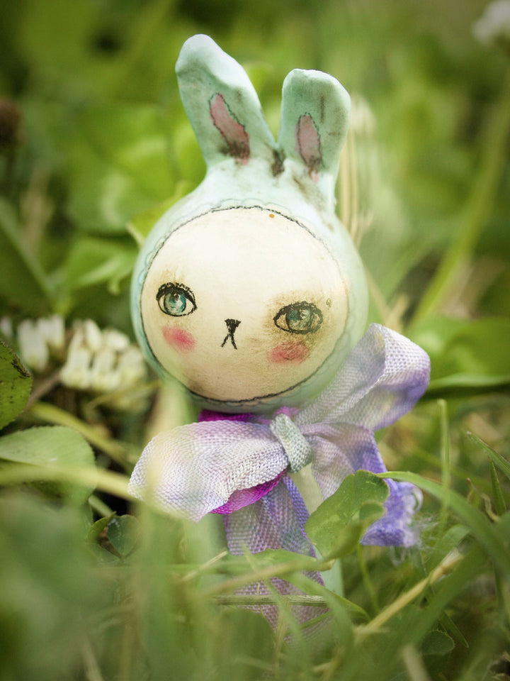 Adorable little handmade kokeshi Easter bunny rabbits are hopping along to Danita Art's studio, where she made them with wood and paper clay.