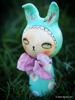 The Easter bunnies are coming, the Easter bunnies are coming!  Spring has sprung early at Danita Art and a pack of wild Easter kokeshi bunny rabbit dolls has made my shop their home while they are waiting to be adopted. don't worry, they may be wild but they can easily tamed with love and candy bribes. They are already taking over my heart, and I am sure each one of them will steal your heart too.