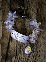 The cheshire cat lives again on this beautiful handmade bracelet with metal, glass and wire wrap jewelry work by Danita Art