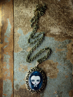 Wednesday Addams is featured in one of Danita's beautiful handmade jewelry necklaces
