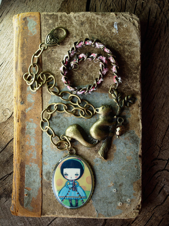 A beautiful, one of a kind necklace created by Danita Art using mixed media techniques in metal and fabric, in a unique piece of wearable art.