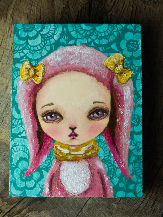 A pop surrealism self portrait of Danita as a pink, fluffy bunny in mixed media.