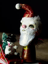 Santa in his magic sled, a holiday wood kokeshi art doll created by Danita Art
