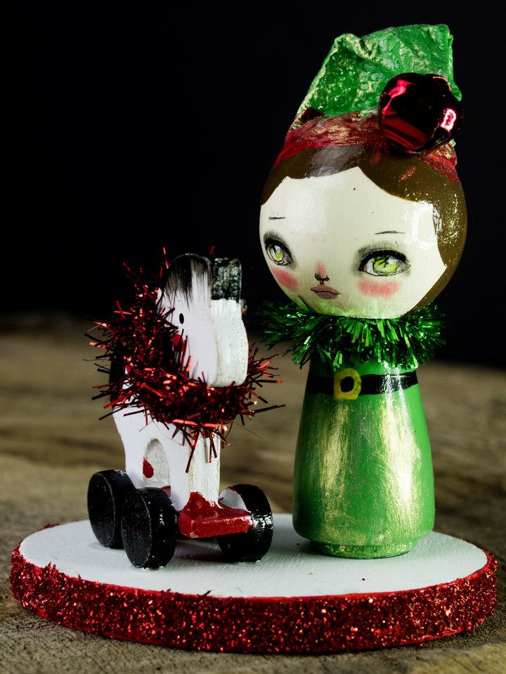 Santa's little helper, a holiday wood kokeshi art doll created by Danita Art