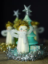 The angel of creativity, a holiday wood kokeshi art doll created by Danita Art