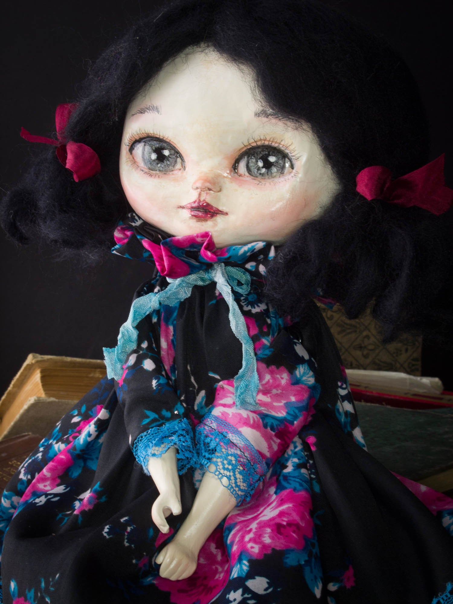 Pauline, a beautiful handmade art doll created by Danita Art with mixed media techniques, fabric and paper clay to create a sweet face with amazingly expressive blue eyes.