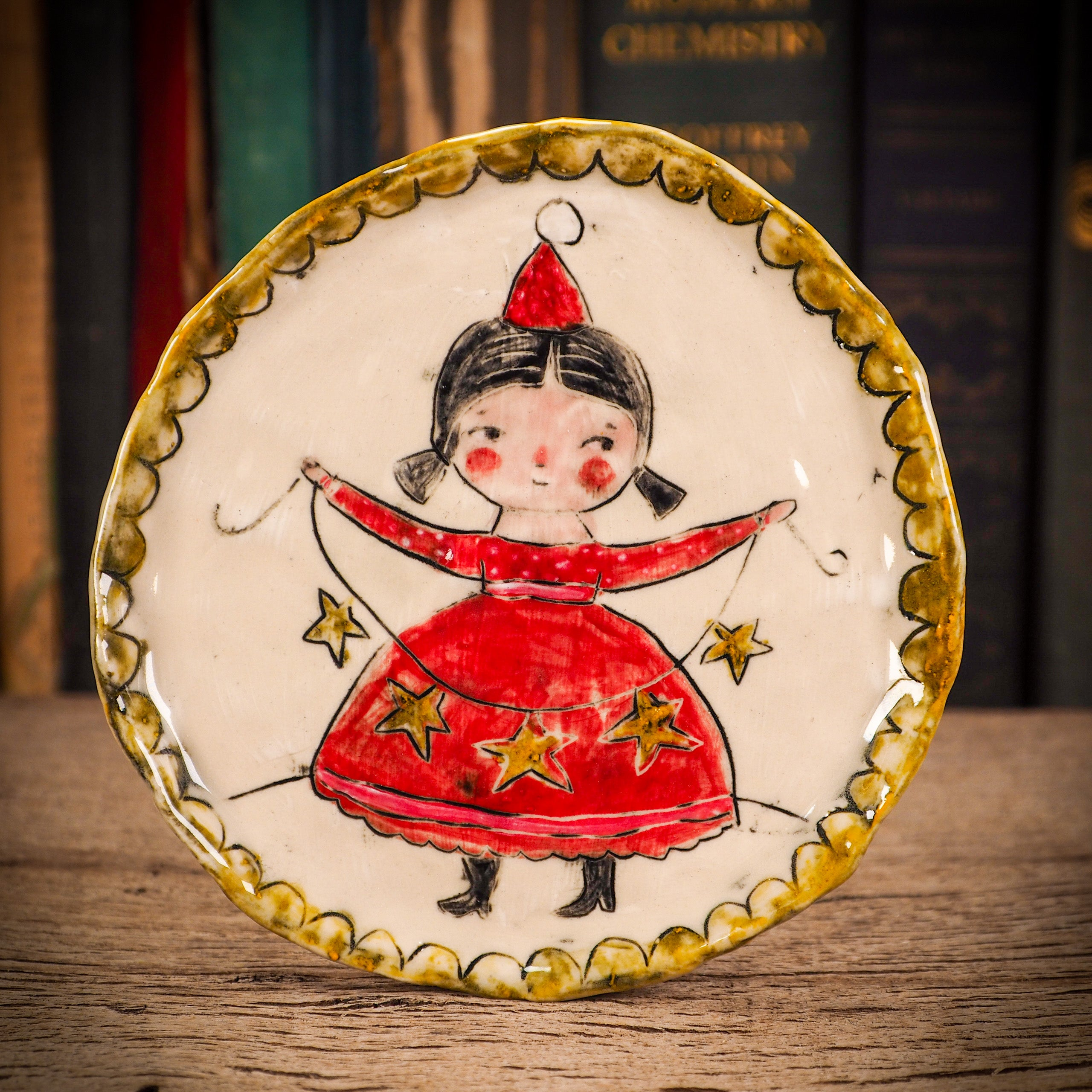 An original Christmas Holiday cake dinner plate round glazed ceramic dinnerware handmade by Idania Salcido, the artist behind Danita Art. Glazed carved sgraffito stoneware, hand painted and decorated, it is illustrated by hand with snowmen, Christmas trees, Santa Claus, angels and snow balls and winter themes.