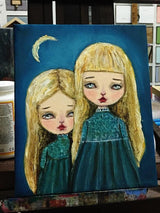 The daughters of the moon walk out at night, exploring under the watchful eyes of their pale mother on this original oil painting on canvas by Danita Art.