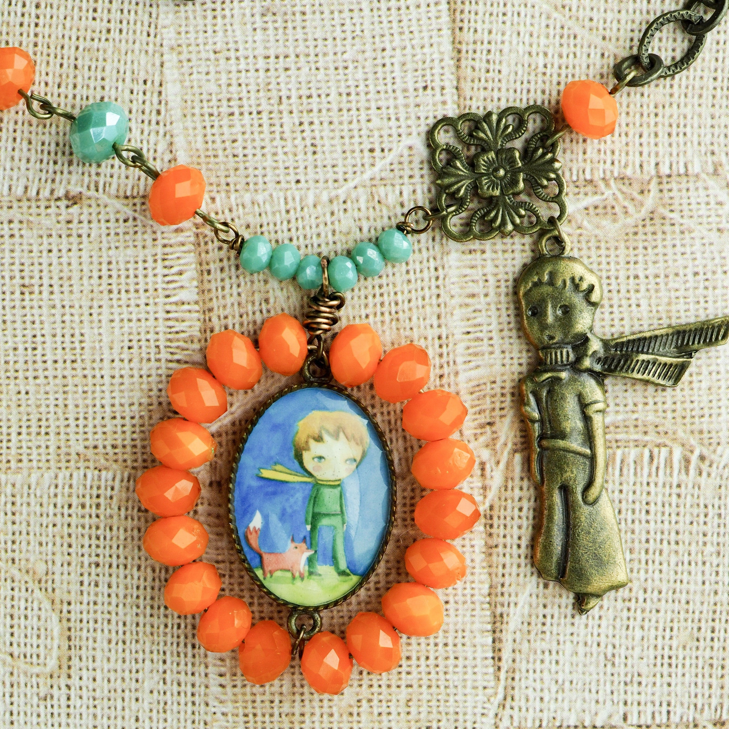 The little prince lives in this handcrafted necklace. Hand made by the talented mixed media artist, Danita.