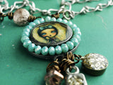 An original necklace hand made by Danita Art. Pewter and brass combine to create a handcrafted piece of wearable art.