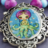 Octopus mermaid girl necklace by Danita. One of a kind jewelry with faceted glass beads.