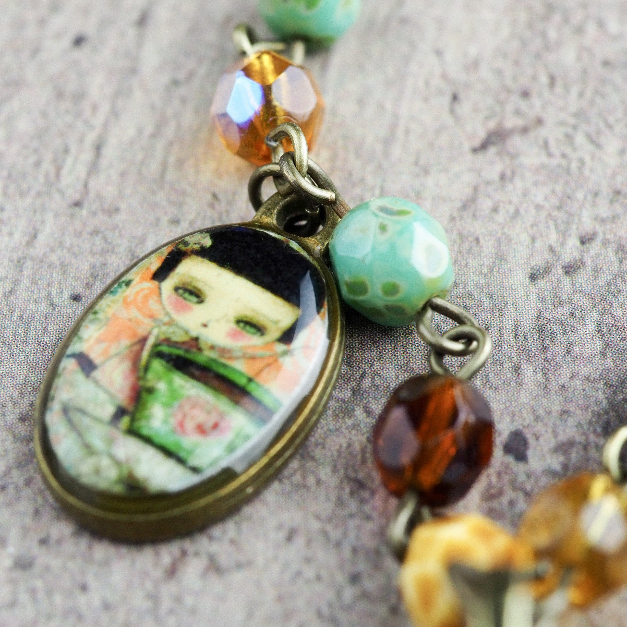 Original mixed materials necklace by Danita Art. The Tea Fairy, a whimsical mixed media illustration.
