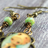 The queen bee. Original jewelry handmade by Danita with prints of original mixed media and watercolor paintings.