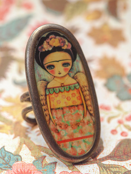 Frida has angel wings on this amazing handmade ring made by Danita Art. It's the perfect accessory for any outfit for your own unique style.