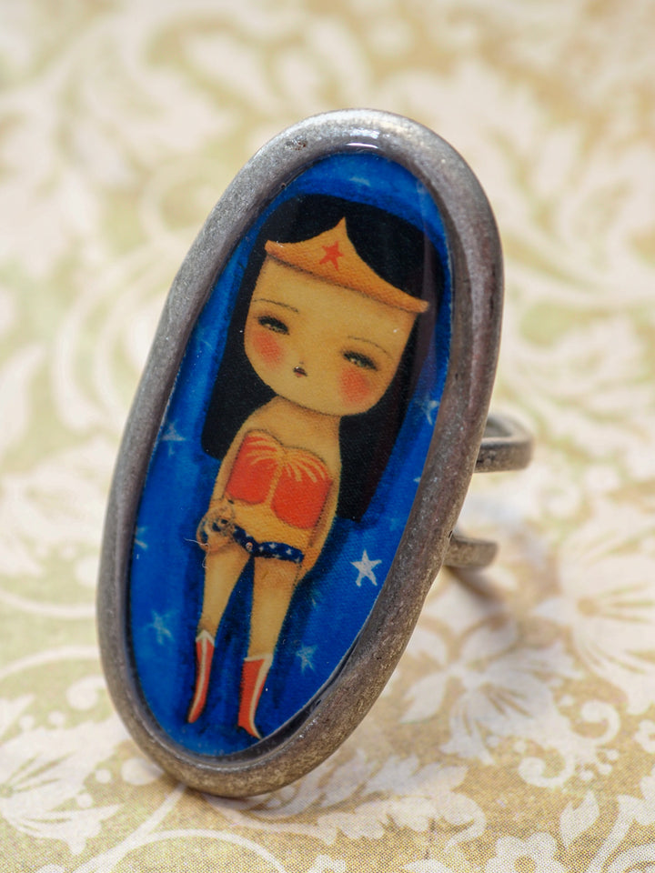Wonder Woman empowers you with this amazing handmade ring made by Danita Art. It's the perfect accessory for any outfit for your own unique style.