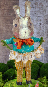 "Spring always inspires Danita to make beautiful handmade decorations for when the flowers start to bloom, just like this 10"" spun cotton handmade Easter bunny rabbit art doll by Danita, hand painted and dressed in a blue polka dot shirt and striped pants."