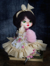 Danita original art doll handmade, sitting with black hair and a big bow.