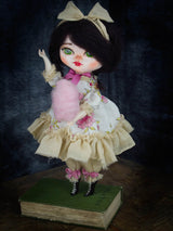 Belle the handmade doll by danita has a hand crafted dress and a beautiful paperclay face.