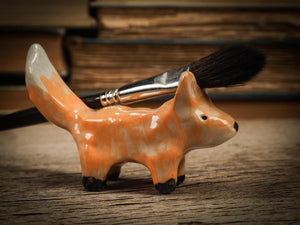 Original handmade ceramic artist color pencil brush holder red fox by Idania Salcido, Danita Art. Unique ceramic art designed and hand built Idania Salcido beautiful handmade touch to any artist's studio with handmade glazed ceramic good for watercolors acrylics inks and oil paints. Clean with water or mineral spirits.