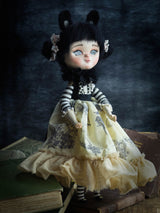 An original Danita art OOAK doll handcrafted with big blue eyes and felted wool hair.