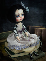 A Danita original and one of a kind hand made art doll. She is made with paper clay, glass eyes and handmade clothes.
