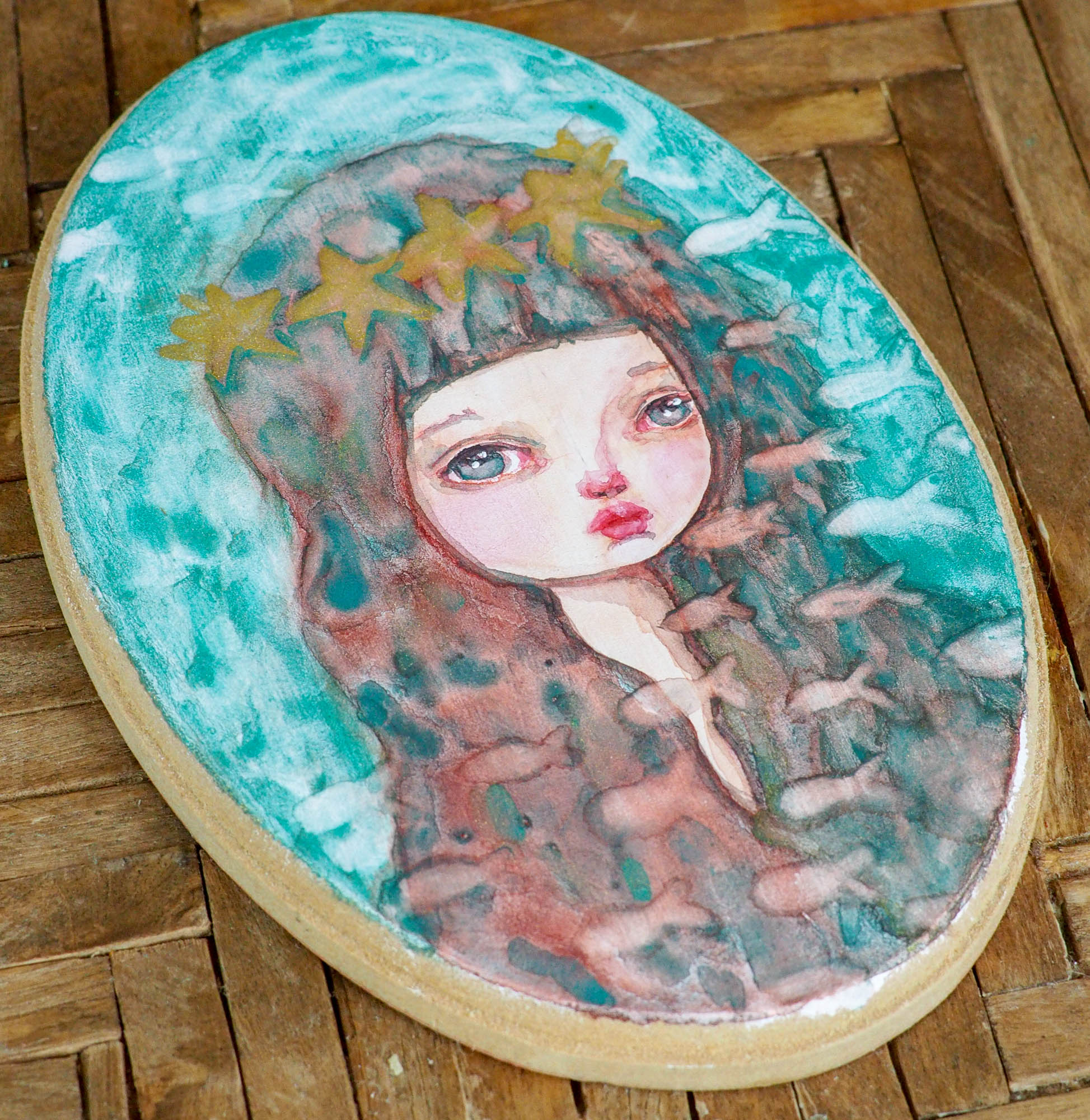 Mermaids are part of danita's painting repertoire, I love painting them! I am painting lots of watercolors now due my lack of space, but that has not stopped my creativity! I got a few oval wood panels and I have been using them to paint original watercolor paintings and illustration.
