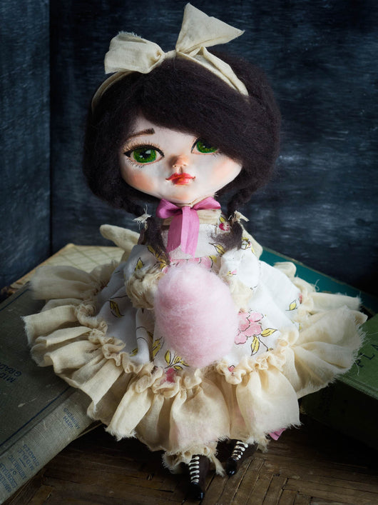 Danita art handmade belle doll. Sweet cotton candy is the favorite food for this little girl with big lively green eyes.