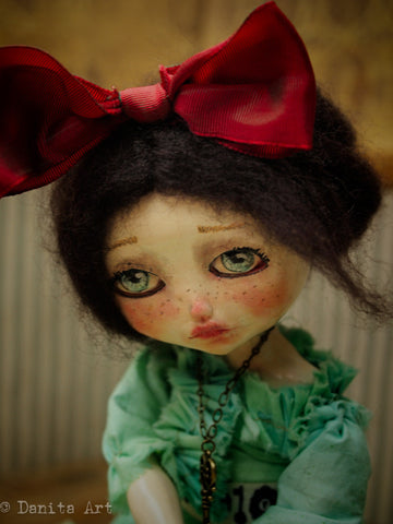 This beautiful art doll by Danita Art has an amazingly beautiful face, and eyes that are on the brink ot crying. There's a story to tell behind those teary eyes, and you can find out about it when you adopt her from danitaart.com