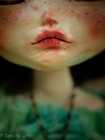 A closeup look on Danita's beautiful art dolls. You can see the detailed lips and freckles that give this doll a lifelike and soulful look.