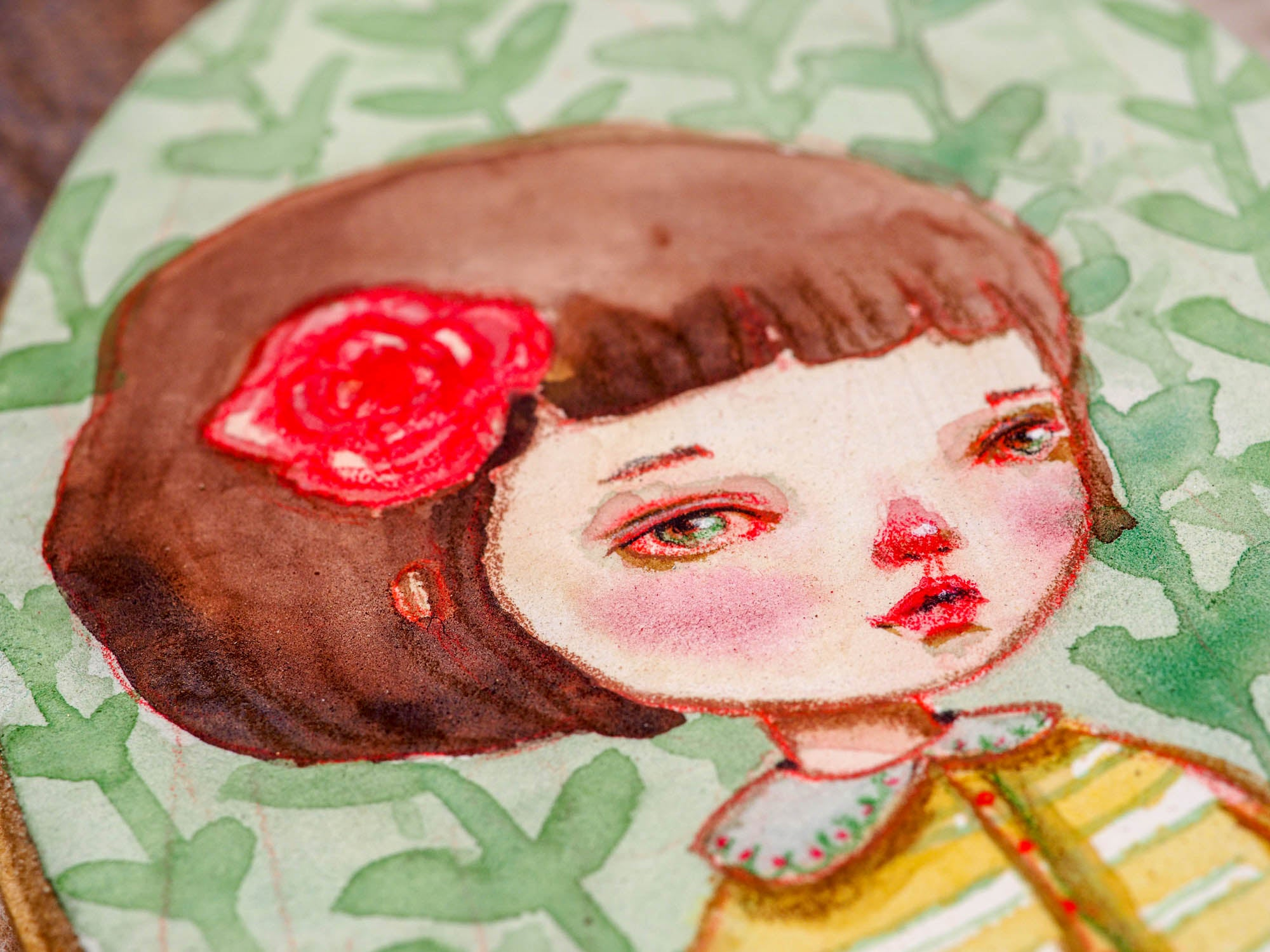 Continuing with Danita's series of watercolor portraits in wood, I painted this beautiful brunette with a red rose in her hair.  The painting measures 5 x 3 inches on a wood panel, painted using saturated watercolor pigments and my signature melancholic eyes on her face.  She has a friend you can adopt too!