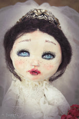 This beautiful bride doll by Danita Art has wool hair and a beautiful vintage tiara.