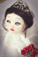 This doll bride dressed with a handmade wedding dress was made by fantastic doll maker and mixed media artist, Danita Art.