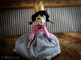 thi art doll by Danita can sit a shelf or she can be placed on a doll tand. either way, she is just gorgeous.