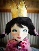 Only becauseher handmade golden crown is made out of paper, it does not mean that this art doll by Danita is less than a royal princess.