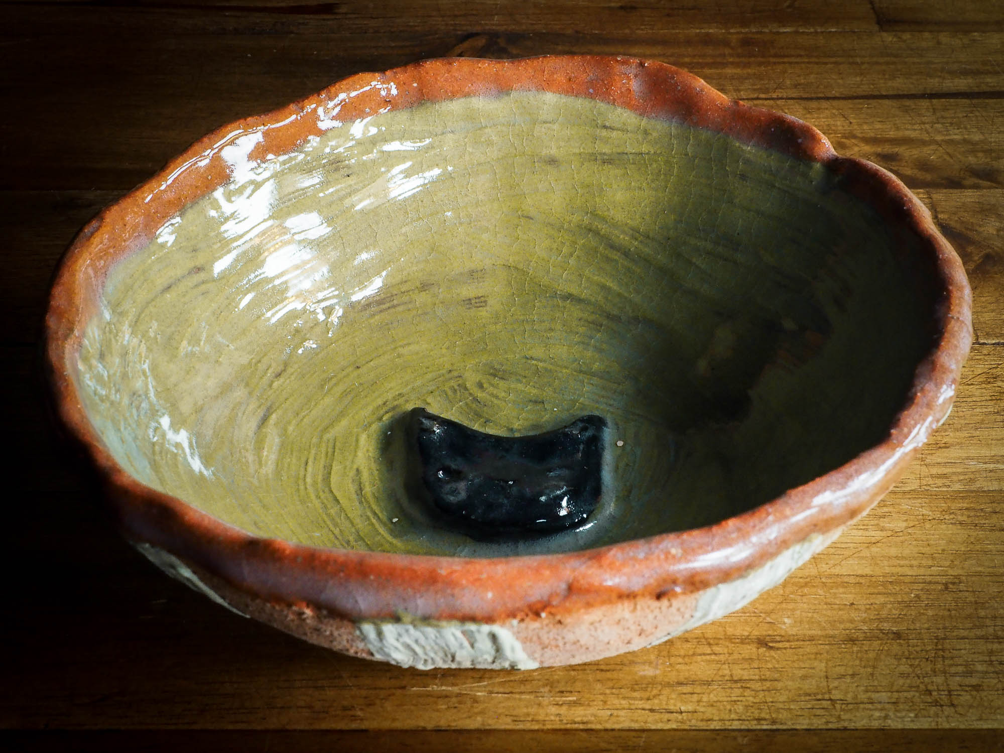 An original Idania Salcido Danita Art pinched ceramic white cat pet food bowl. Handmade from locally foraged clay, this glazed ceramics one of a kind artwork is perfect for any kitchen plate and bowls unique collection. A hand made black cat waits for you at the bottom of this brown and green striped pet food bowl.