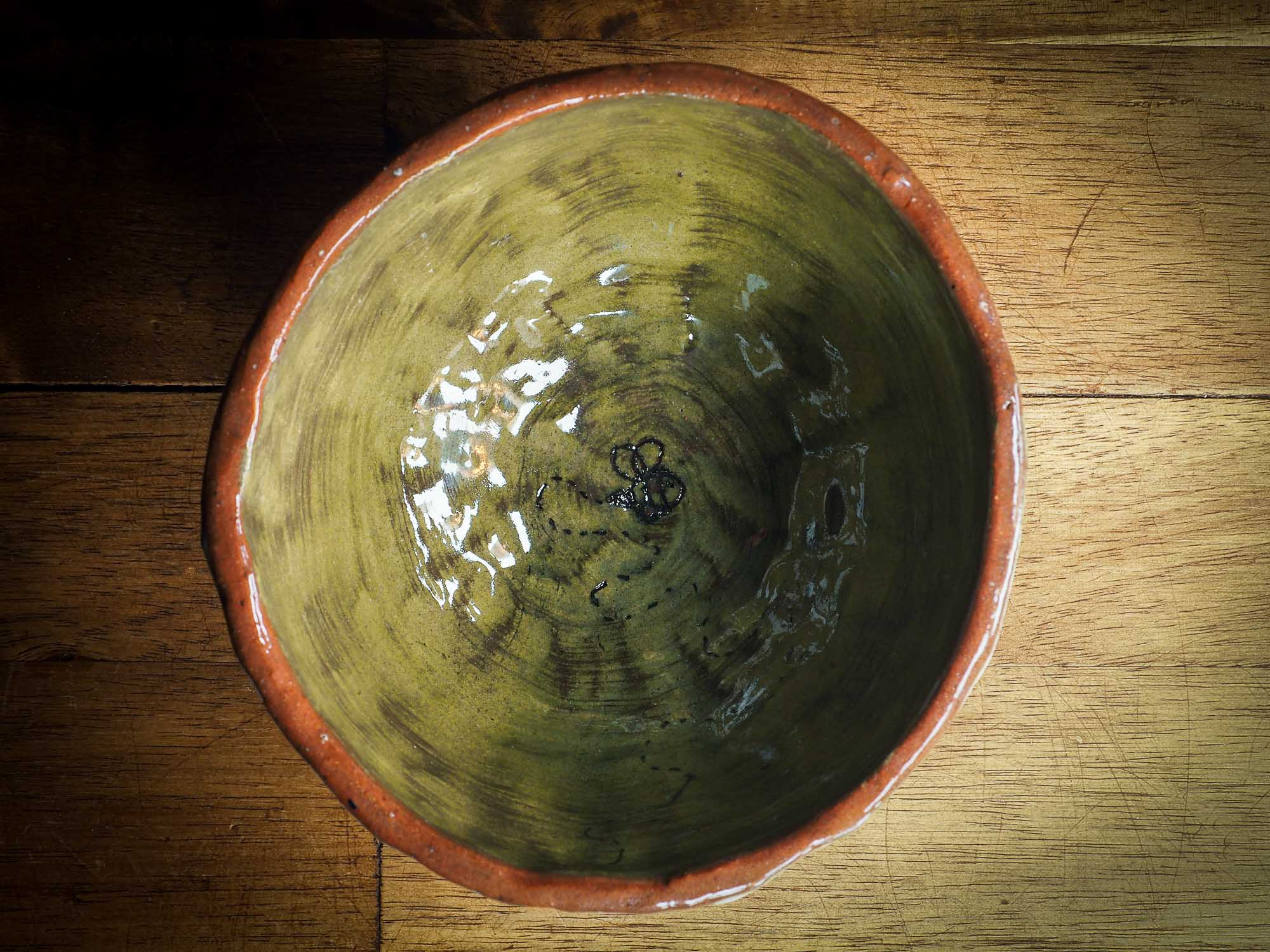 An original Idania Salcido Danita Art pinched ceramic cat pet food bowl. Handmade from locally foraged clay, this glazed ceramics one of a kind artwork is perfect for any kitchen plate and bowls unique collection. Thumbprints and  intentionally irregular shape give the bowl a cozy, warmly familiar feel when you pick it