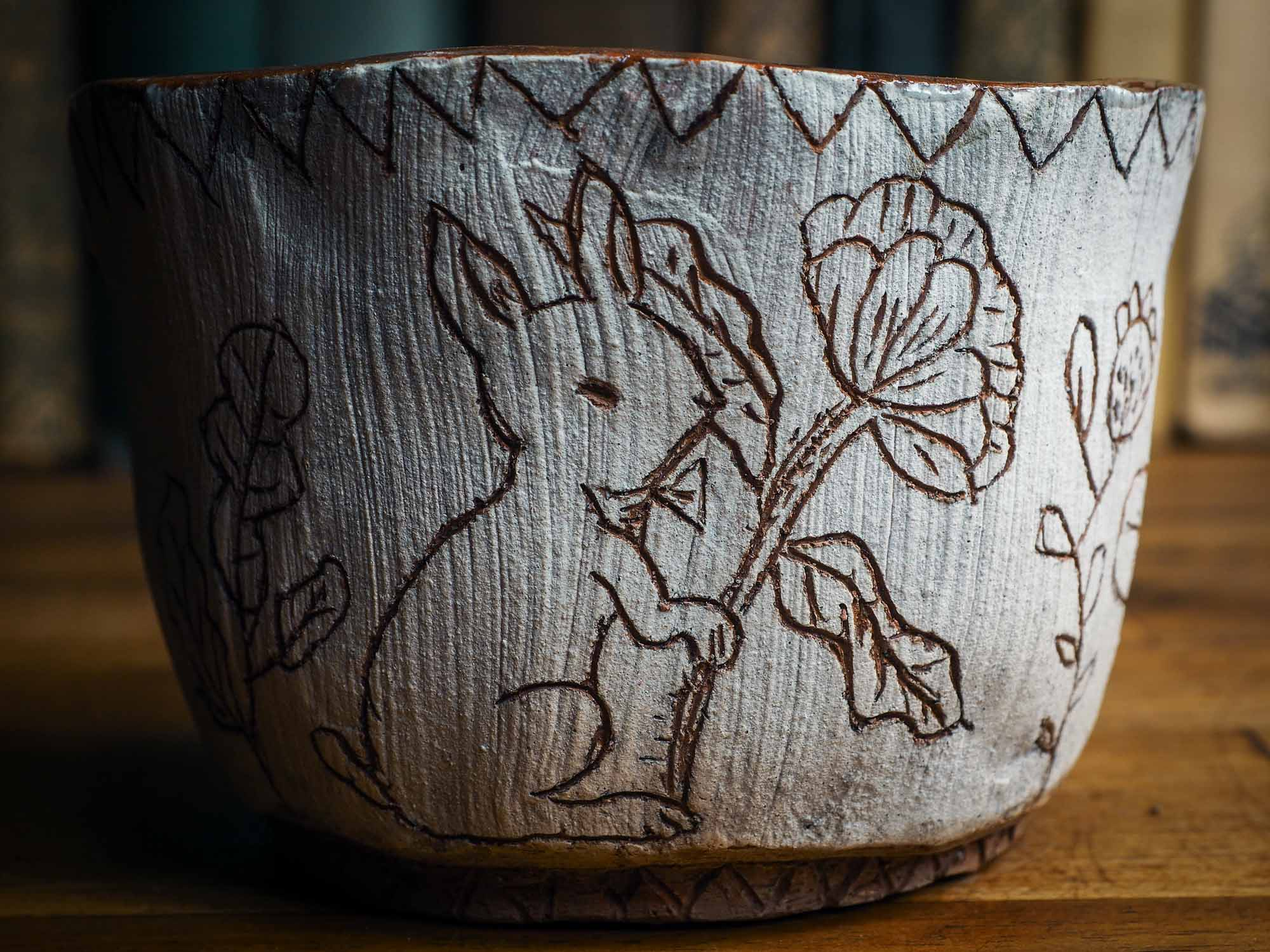 An original Idania Salcido Danita Art pinched ceramic cat pet food bowl. Handmade from locally foraged clay, this glazed ceramics one of a kind artwork is perfect for any kitchen plate and bowls unique collection. Thumbprints and  intentionally irregular shape give the bowl a cozy, warmly familiar feel when you pick it. A cute little white rabbit is carved on the sides.