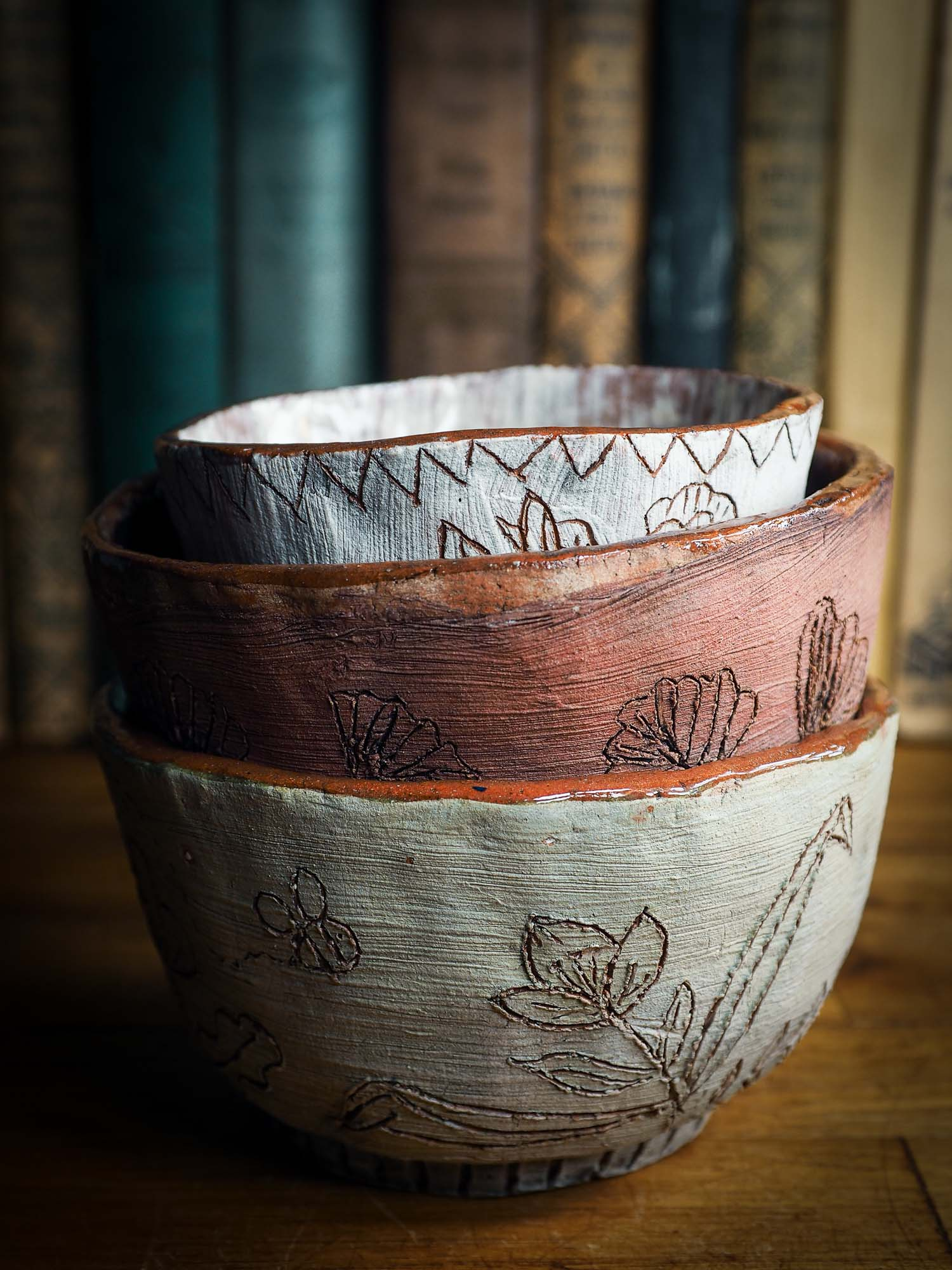 An original Idania Salcido Danita Art pinched ceramic cat pet food bowl. Handmade from locally foraged clay, this glazed ceramics one of a kind artwork is perfect for any kitchen plate and bowls unique collection. Thumbprints and  intentionally irregular shape give the bowl a cozy, warmly familiar feel when you pick it.