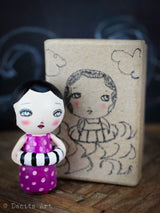 The hand made wood kokeshi art dolls made by Danita art are adorable on their own, and they always come on the most original containers to keep them safe.