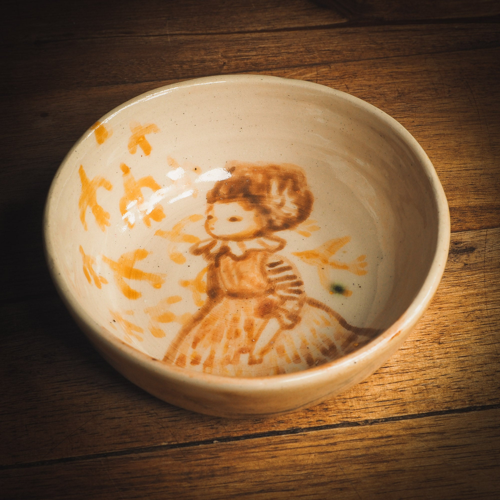 An original Idania Salcido Danita Art ceramic cat pet food plate. Handmade from stoneware, this glazed ceramics one of a kind artwork is perfect for any kitchen plate and bowls unique collection. Thumbprints and  intentionally irregular shape give the bowl a cozy, warmly familiar feel when you pick it. A flock of yellow birds greets a beautiful girl in a striped dress, painted in watercolor style underglaze by Danita Art.