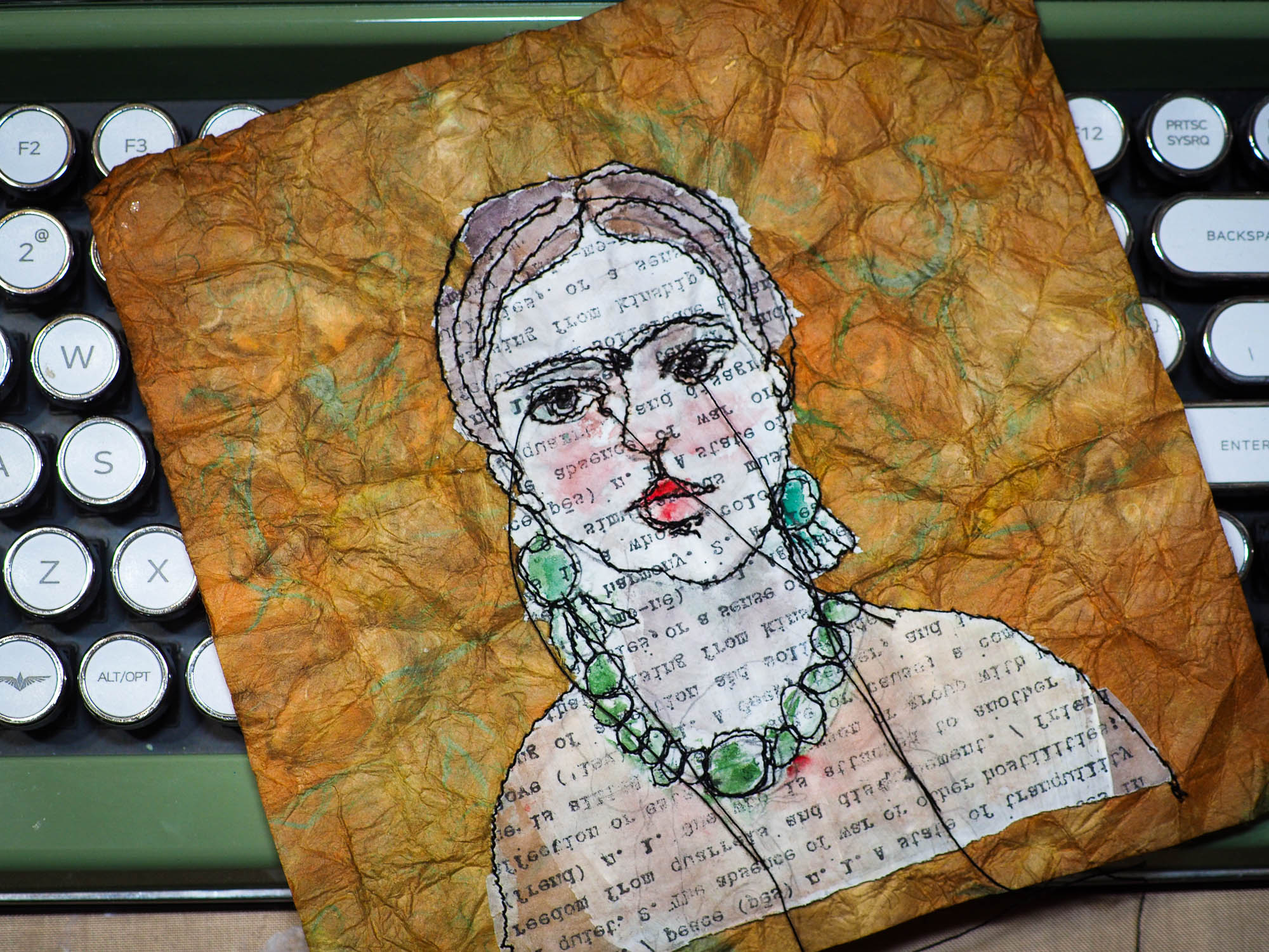 Freehand embroidery painting by Danita Art. Sewing using free motion stitching and embroidery, Danita created a beautiful textile and fabric art original artwork with famous Mexican artist Frida Kahlo featured in a one of a kind portrait.