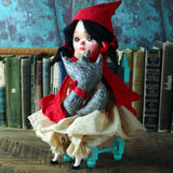 Original hand made art doll by Danita. Little red riding hood pays with her wolf friend. Everything hand crafted, a unique piece of art by Danita.